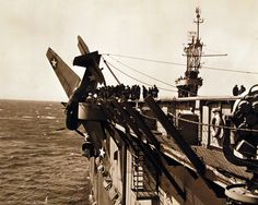 80-G-38877: Crash of TBF-1 on deck of USS Charger (ACV 30). Photographed March…