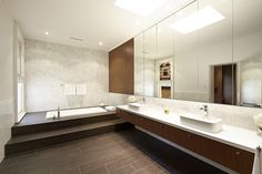 timber vanity....marble wall tiles...