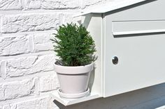 wall mounted mailbox with self-watering plant shelf