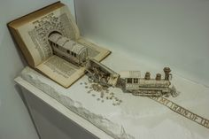 This awesome book sculpture is by Thomas Wightman and is the most recent of the series. To convey this metaphor the sculpture shows a train travelling on a journey that has become disrupted, Magazine Deco, Train Of Thought, Visual Metaphor, Altered Book Art, Up Book, Paper Book, Book Folding, Book Crafts, Paper Crafts
