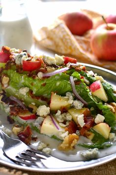 This Apple Wedge Salad is loaded with fresh apples, chopped walnuts, crispy bacon, and gorgonzola cheese, then topped with a sweet, creamy golden balsamic dressing! The perfect salad for fall!
