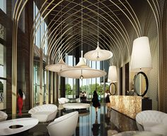 Inspiration for the Wuxi Hotel was neogothic, the main theme of the Visionnaire concept from the start. The pivotal feature is the lobby - the image evoked is that of the nave of a gothic cathedral. A series of bronzed steel pipes form the lancet arches and ribbed vaults of the nave. Walls are covered by a bronze/gold steel mesh that celebrates the luxury theme. An large desk in warm colored marble supports two witty oversized interpretations of the iconic Visionnaire Egg lamp.