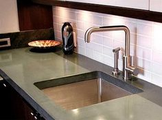 polished concrete countertops in the kitchen - http://www