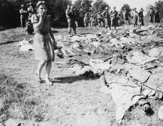 A German girl is overcome as she walks past the exhumed bodies of some of the 800 slave workers murdered by the SS guards near Namering, Germany, and laid here so that townspeople may view the work of their Nazi leaders.