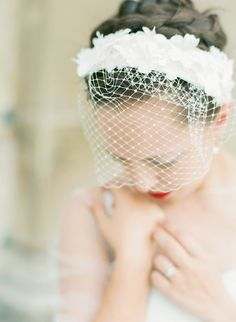 Bird cage veil and red lipstick