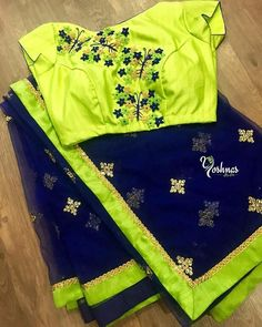 Navy blue net saree with Green embroidery blouse from Yoshnas By Ela.They can customize the size and colour as per your requirement. To order please reach us on 7550227897 / 044 13 October 2017 Saree Designs Party Wear, Wedding Saree Blouse Designs, Silk Saree Blouse Designs, Saree Blouse Patterns, Blouse Back Neck Designs, Simple Blouse Designs, Stylish Blouse Design, Jute, Chiffon