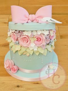 This was made for my mums friend as a surprise. I was set the challenge of creating an open hat box cake with pink roses and flowers popping out. I was initially quite worried I wouldn't be able to do it but I LOVED making this cake, it's perfect....