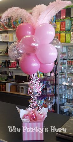 Deluxe Sweet heart Topiary for Valentine's Day. Includes feathers, balloons and 10 heart chocolates. Customise it and select your own colours. Long lasting, air filled arrangement perfect for a gift or a table centrepiece.  www.thepartyshere.com.au   #valentinesday #2015 #heart #love #pink #balloons #valentines #gift #balloonartist #chocolates