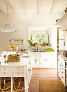 Country Farmhouse Kitchen Design I'm intrigued with the baskets under the island to hold potatoes and such.