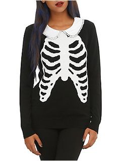<p>Black sweater from Iron Fist with a rib cage design, pom accented peter pan collar and keyhole back accent.</p>  <ul> 	<li>100% Acrylic</li> 	<li>Wash cold; dry flat </li> 	<li>Imported </li> 	<li>Listed in junior sizes </li> </ul>  <p> </p>  <p> </p>