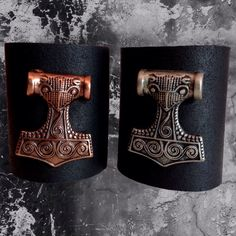 Thor's Hammer leather cuffs