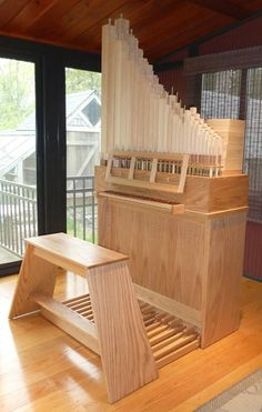 This organ was designed as the minimum instrument required for practice.  There is a single keyboard controlling a single rank of pipes.