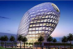Mumbai Office Building, Mumbai, India. James Law Cybertecture International. It's an egg on its side, some have built the egg shape before but it has always been vertical. This design is taking that vertical egg shape and tipping it on its side; it is taking something that has been done and putting a new spin on it.