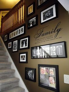 Picture frames on stair wall. Love this!!!! U could probably do it on any wall. Love  the word family in center