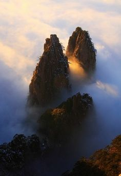 (huang Shan In China) Mountain Parts Partly Enshrouded By Cloud And Fog.the Sunlight Gives A Nice Contrast! Beautiful Photography!