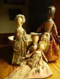 A wonderful group of small wooden dolls by kathy patterson