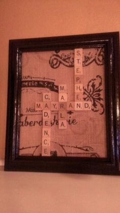 Made this mini version of the scrabble wall art i posted on my crafts board.  Just spray paint an old frame, used some burlap as the back, and arranged my scrabble tile pieces into all of our names.