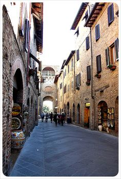 San Gimignano street: The small town of 7,000 keeps these streets car-free, allowing visitors to stroll at a snail's pace, sampling Italian sweets, cheese, bread and wine-tastings, the gelaterias with the creamiest gelato and pizza places keeping taste buds bursting with deliciously unique combinations. Work it all off with a climb up the hundreds of steps to the top of Torre Grossa on Popolo Square for 360-degree views of the most picturesque Tuscan countryside of anywhere in the region.