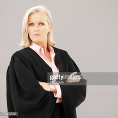 77005536-female-barrister-with-arms-crossed-portrait-gettyimages.jpg (414×414)