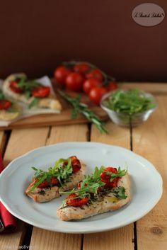 Pollo al forno con pomodorini e rucola