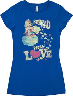 This Care Bears shirt features an image of Tenderheart Bear dumping out a bucket of hearts and the shirt reads Spread The Love. Tenderheart Bear is one of the original Care Bears that first appeared o