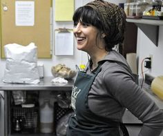 Alicia Landucci makes a fresh batch of vegan chocolate chip cookies April 7 at Good Earth Co-op in St. Cloud.