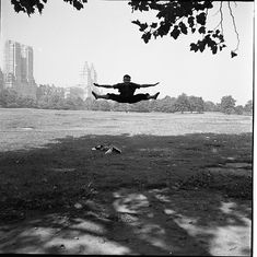 by Vivian Maier : Man Doings Splits in Mid Air, Central Park, NY, 1955