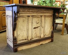An island/bar from reclaimed doors. Would make for a great fixture in a rustic store or a down home kitchen.