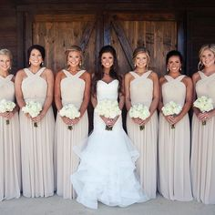 I like the style of these bridesmaid dresses. Blush or navy blue?? Love the wedding dress!
