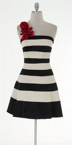 One black and white striped bridesmaid dress, without the red flowers. Hot pink instead For the Black/White/hot pink theme.