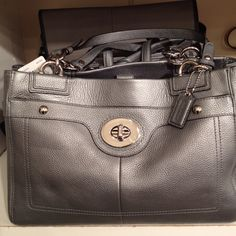 Coach pewter carry all :)