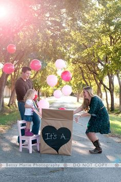 Cute sibling gender reveal. Suprise! It's a.....Corey wouldn't understand it but it could make for some cool pics for out of town family.
