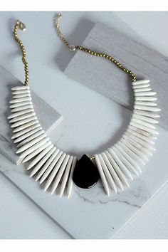Gold Tone Statement Necklace with Ivory Spike Detail and Black Teardrop Shape Medallion
