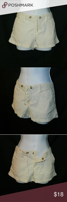 AMERICAN EAGLE Cream pinstripe shorts Very pretty cream shorts with stitching pinstripe detail. Great for casual wear. 3 buttons, 1 hook, and tie closure. 4 pockets. Light weight material. 100% cotton. Size 2. In very good condition.                                             Approximate Measurements: Total length waist to hem = 10 in; Inseam = 2 3/4 in; Half waist = 15 in. American Eagle Outfitters Shorts