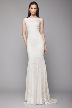 Off White Silk thread embroidered Tulle mermaid dress with sheer neckline and hemline.