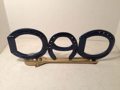 """""""DAD"""" Written in Horseshoes welded to an old crescent wrench"""