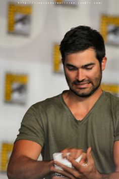 """Tyler Hoechlin making his nameplate into a ball to through to the crowd in front of the stage . Hehe . The face ""- text by timecanberewritten - fuckyestylerhoechlin"