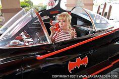 Barbara poses in the Batmobile at The Garden State 2011 Comic Con.