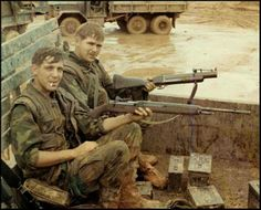 M-79 40mm Grenade Launcher and M-14 7.62x54mm Rifle. Picture is early Vietnam. M-14's where replace by M-16 5.56mm Rifles.