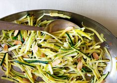 2 pounds summer squash and/or zucchini, cut into matchsticks 1 teaspoon kosher salt plus more 1/4 cup sliced almonds 2 tablespoons olive oil 2 garlic cloves, sliced 1/4 teaspoon crushed red pepper flakes 1/4 cup finely grated Parmesan Freshly ground black pepper