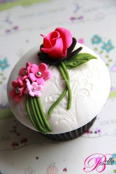 White embossed cupcake topper with flower bouquet and rose