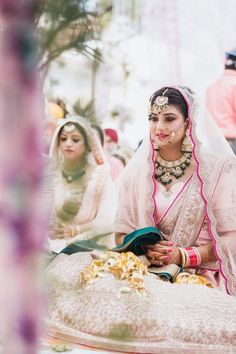 Sikh Wedding Brides: Gorgeous pastel pink lehenga for wedding. See more on wedmegood.com #wedmegood #indianwedding #indianbride #jewellery #jewelry #pinks #lehenga #lehengacholi #bridallehenga #bridallehengacholi #sikhwedding #necklace #earrings