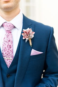 Pink paisley Tie and pocket square with Origami buttonhole   A Mori Lee by Madeline Gardner dress   Pronovias hair accessories   Classic Wedding   Northcote House in Berkshire   Origami flowers   Images by Anushé Low Photography   http://www.rockmywedding.co.uk/jaymi-erjon/