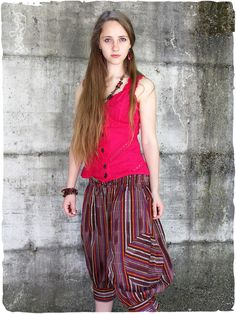 Dory Trousers With #trendy #cotton #trousers from the latest collection of La Mamita you become the trendsetter of the #summer. The summery #cottonpants with 7/8 leg scores mainly with its exceptional cut. A low crotch and elastic cuffs ensure an airy fit. #modaetnica #ethnicalfashion #lamamita #moda #fashion #italianfashion #style #italianstyle #modaitaliana #lamamitafashion #moda2016 #fashion2016 #pantaloni #spring #springfashion #trousers #orientalfashion #pantaloniorientali…