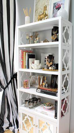 {*LOVE* the quatrefoils on this bookshelf. where do I sign up for one?}