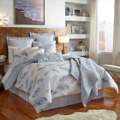 With its array of printed watercolor feathers, the Feather comforter collection from Shell Rummel is brimming with nature-inspired design. In sand and sea glass blue against a cream background. Comforter reverses to a softly textural, chevron-style print.  Available in Twin, Full/Queen and King. Twin Set includes one standard sham. Full/Queen Set includes two standard shams. King set includes two king shams. Comforter is 100% cotton with polyester fill and machine washable.