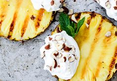 An easy recipe for grilled pineapple with coconut whipped cream and hazelnuts. A healthy, light and vegan summer treat.