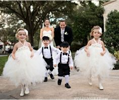 The kids are dressed SO cute.. shorts and suspenders and bow ties for the boys, tutus for the girls..