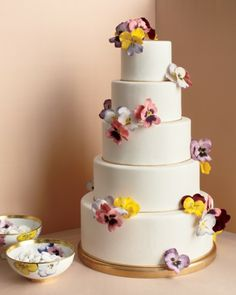 """Pansy Wedding Cake    This five-tier cake takes Bernardaud's """"Pensees"""" pattern—and your wedding—to soaring new heights. It's abloom with hand-painted sugar pansies """"planted"""" into fondant. To wow your crowd, ask your baker for extra blossoms so that one can be served with each slice."""