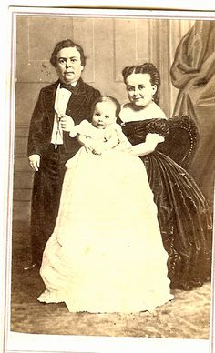 A promotional, give away, photograph of Tom Thumb with his family.  This image came from the estate of a doctor who worked in the field of dwarfism